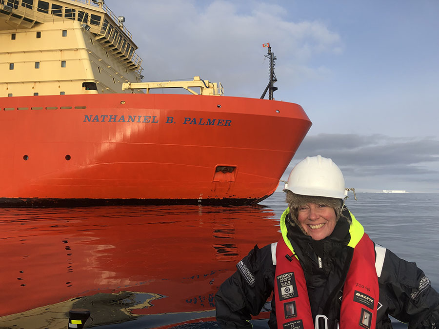 Anna Wåhlin in front of the icebreaker Nathaniel B. Palmer